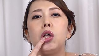 Kazama Yumi plays with long dildo in her mouth for the best fun